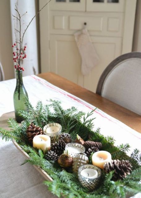 a tray with evergreens, pinecones, bulbs, candles and vintage ornaments