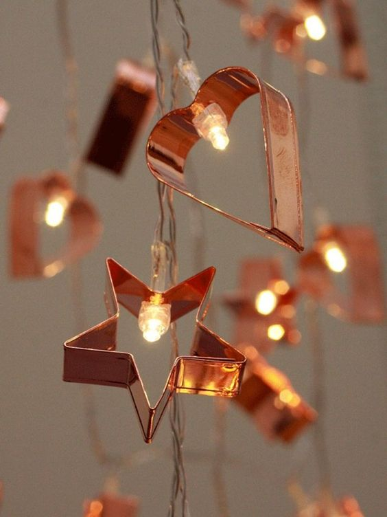 a copper cookie cutter with lights garland is a gorgeous and unusual decoration
