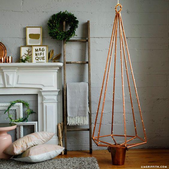 a copper pipe Christmas tree with lights doesn't require any decor, it looks cool itself