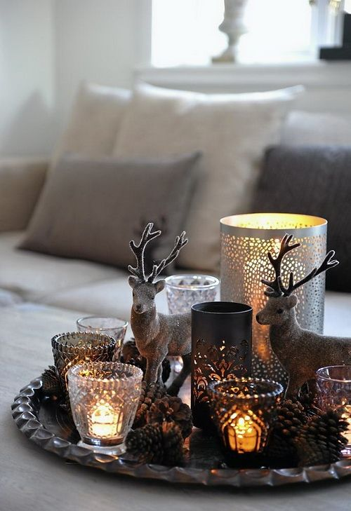 a tray with pinecones, glass and metal candle holders, deer figurines is easy to recreate