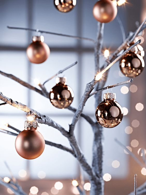 matte and shiny copper ornaments on branches are a great holiday decoration to make
