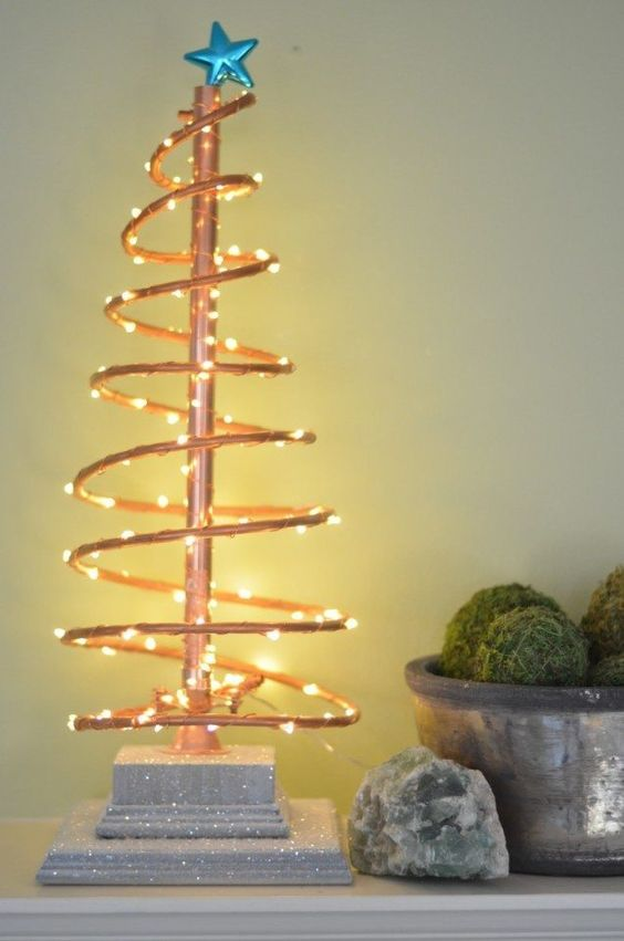 spiral copper tree with lights and a blue star topper