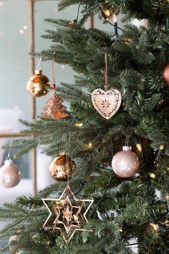 copper and pink ornaments for a pastel and cute christmas tree