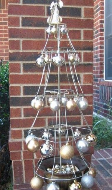 a lampshade Christmas tree with metallic ornaments