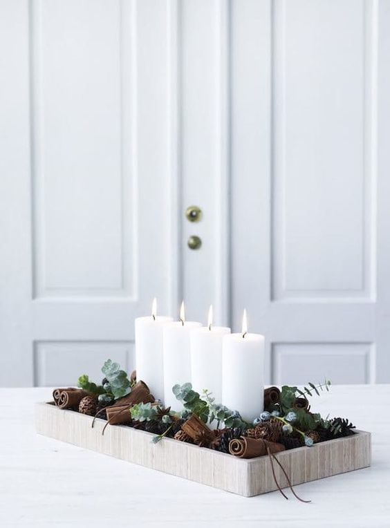 a wooden tray with cinnamon bark, eucalyptus and candles will not only look cool but also smell nice