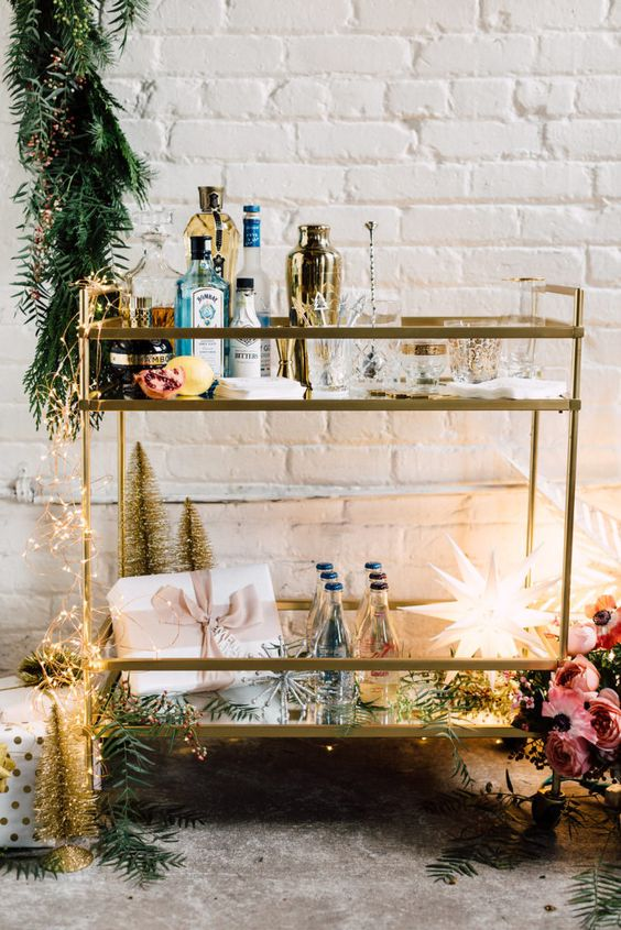 decorate the cart with lights, a shining star and some greenery for an effortlessly chic touch