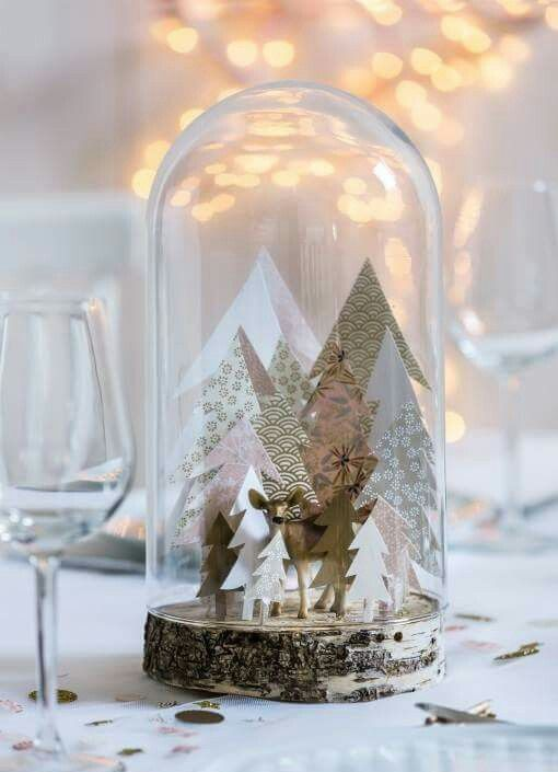 paper Christmas trees and a deer in a cloche with a wood slice base