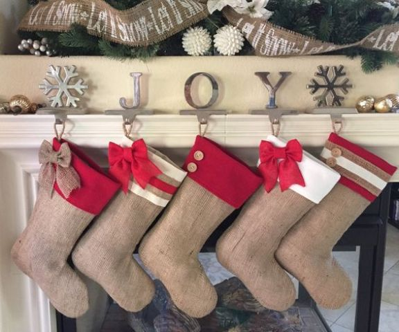 burlap stockings with bows and buttons will be a nice rustic idea