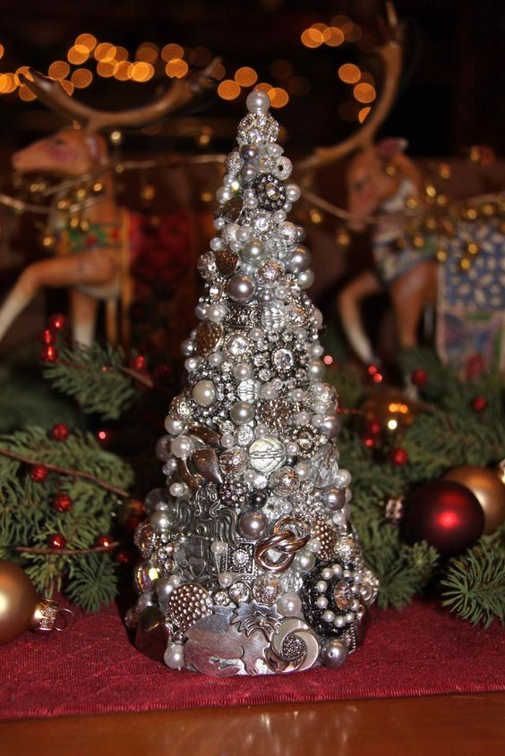 a cute silver Christmas tree of jewelry pieces, pearls and rhinestones for a glam feel