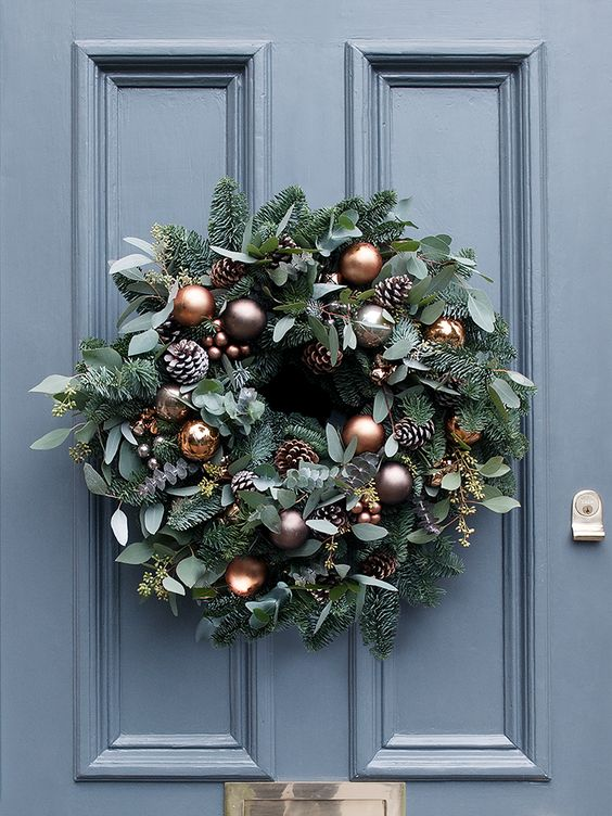 a lush Christmas wreath with pinecones and chocolate and copper ornaments - 15 Chic Copper Christmas Decor Ideas - Shelterness
