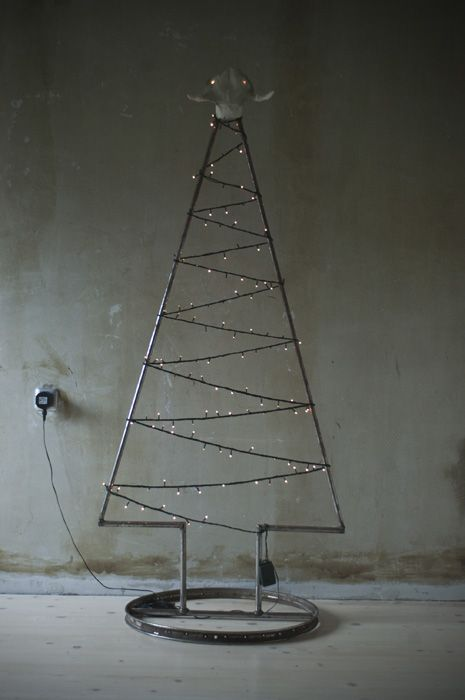 a metal pipe Christmas tree covered with LEDs is all you need for an industrial Christmas
