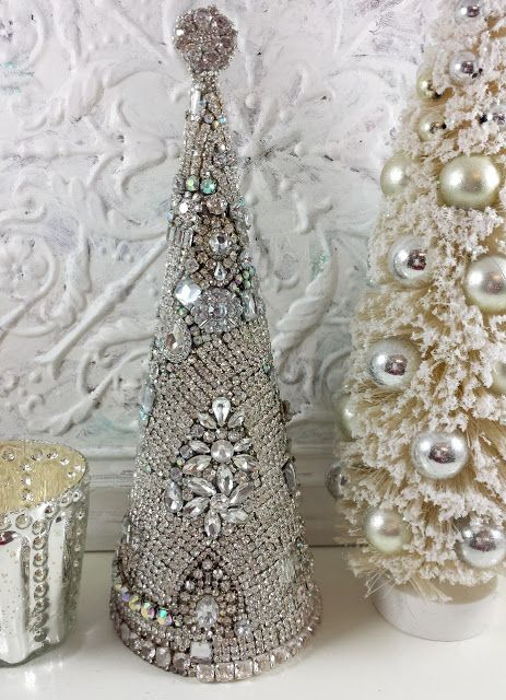 a sparkling Christmas tree of rhinestones and jewelry for a shiny touch