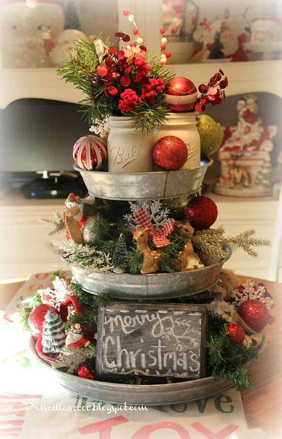 a vintage stand decoration with small trees, deer, ornaments, chalkboard signs and snowflakes