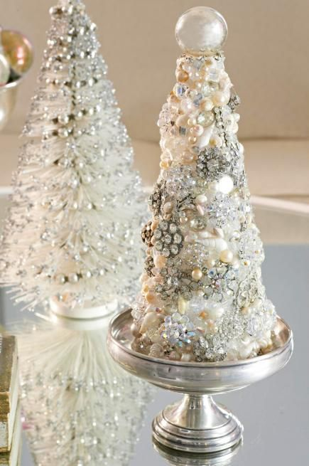 a white Christmas tree made of jewelry, beads and pearls of different sizes and looks