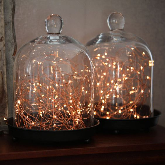 copper lights in cloches are a great lighting idea for Christmas and any other holiday