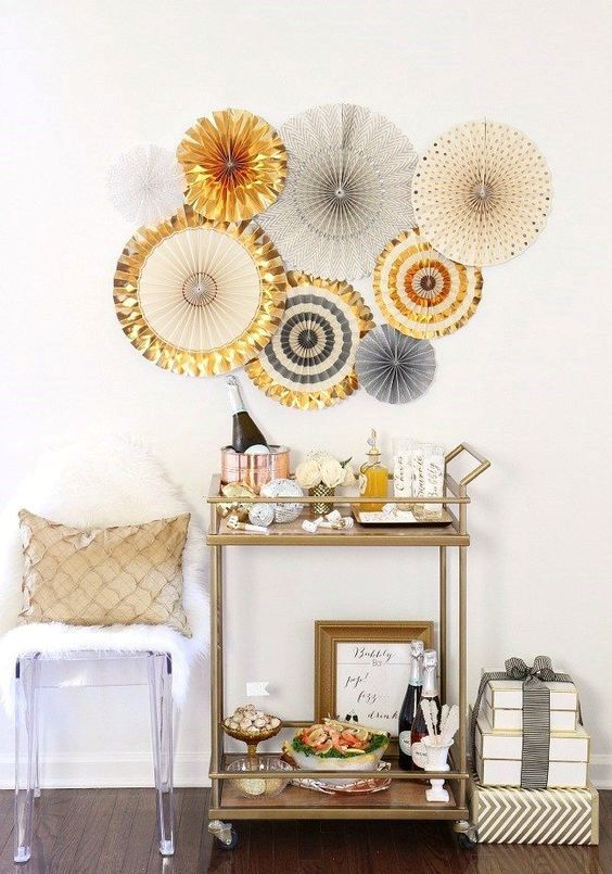 disco ball ornaments and shiny metallic paper fans over the cart is all you need for a festive touch