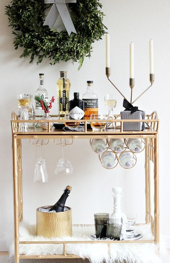faux fur, an exquisite candle holder and an evergreen wreath over the cart