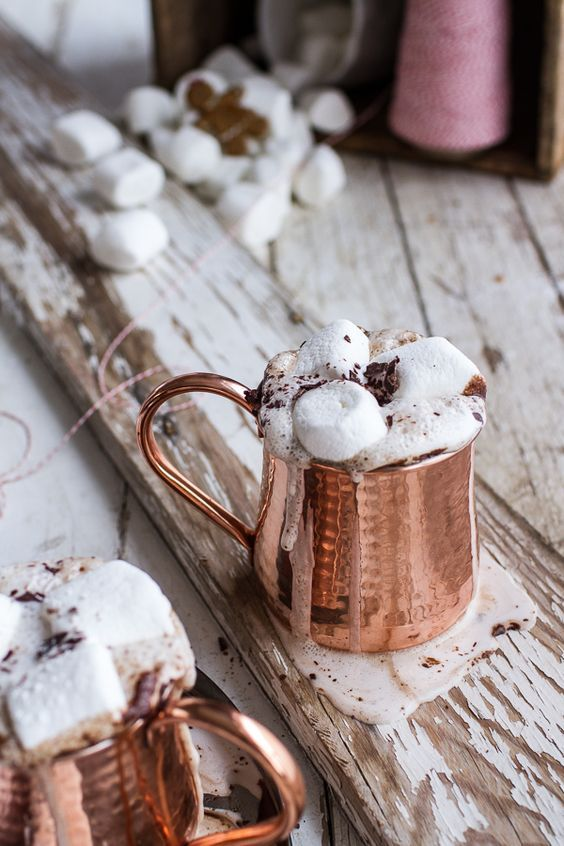 serve hot chocolate with marshmallows in copper mugs