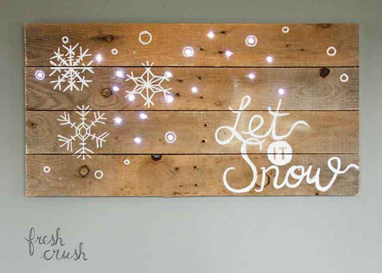 DIY pallet Let It Snow sign with lights (via freshcrush.com)