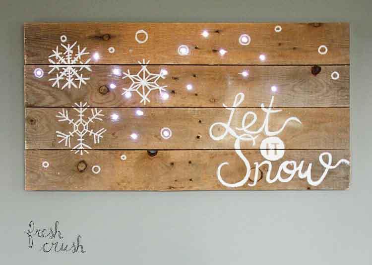 DIY pallet Let It Snow sign with lights (via freshcrush.com)