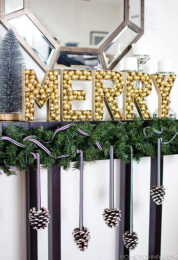 DIY MERRY sign with disco ball ornaments (via www.homeyohmy.com)