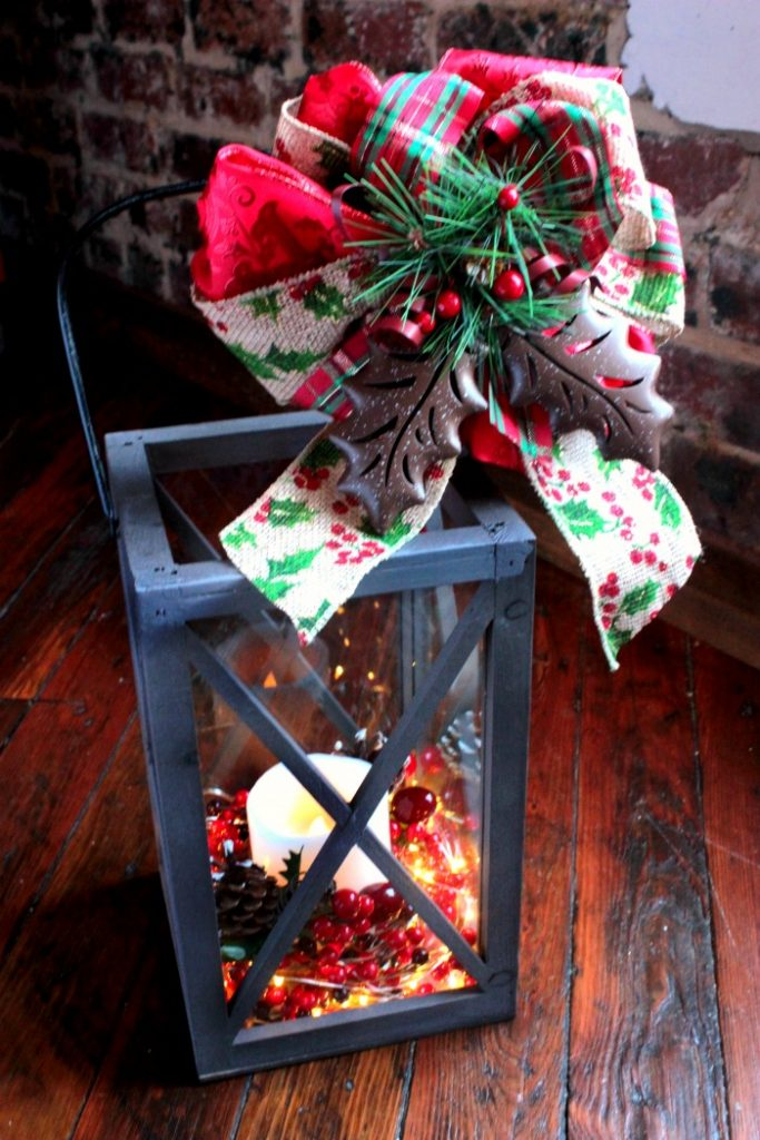 DIY Christmas lantern with various decor on top (via www.bigbearswife.com)