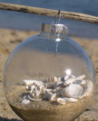 DIY clear glass ornament filled with sand and shells