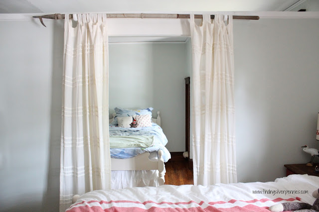 DIY antique boat hook curtain rod (via www.findingsilverpennies.com)