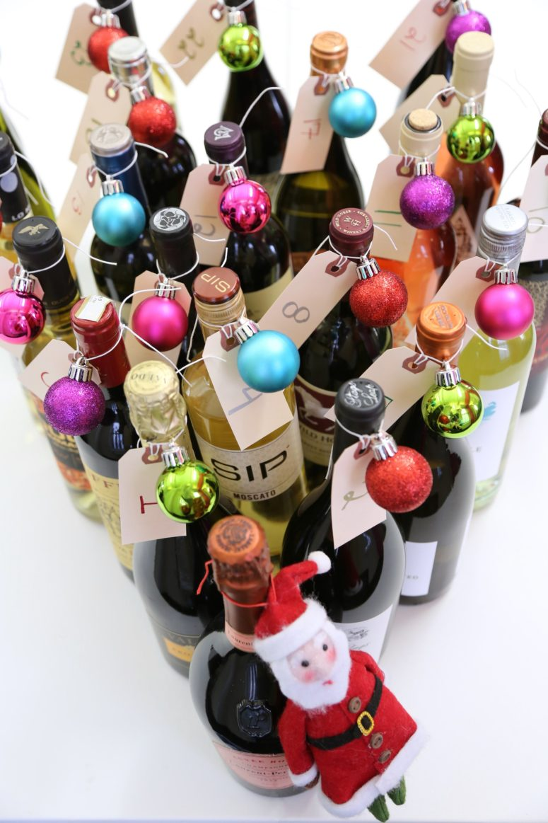 DIY wine bottle advent calendar (via www.popsugar.com)