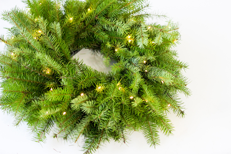 DIY lit up evergreen wreath (via www.deliacreates.com)