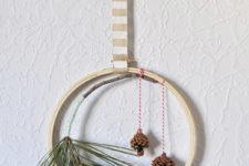 DIY evergreen hanging hoop wreath