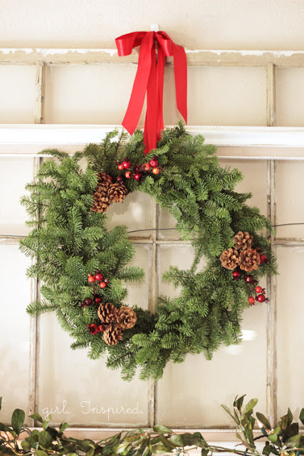 DIY evergreen Christmas wreath with berries and pinecones (via thegirlinspired.com)
