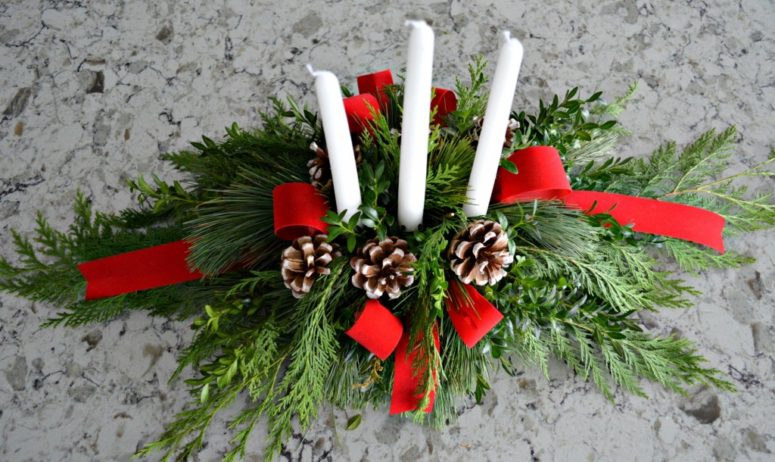 DIY evergreen Christmas centerpiece (via celebrateanddecorate.com)