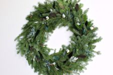 DIY evergreen, fake birds and feathers wreath