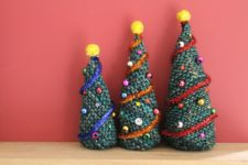 DIY knit Christmas trees decorated with beads and pompoms
