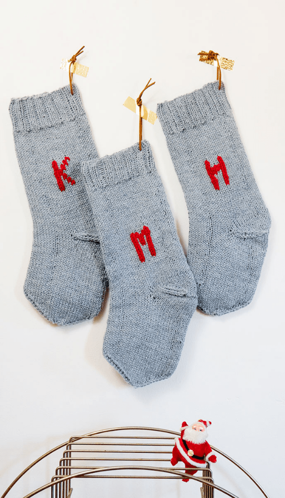 DIY knit grey stockings with monograms (via www.maidenmag.com)