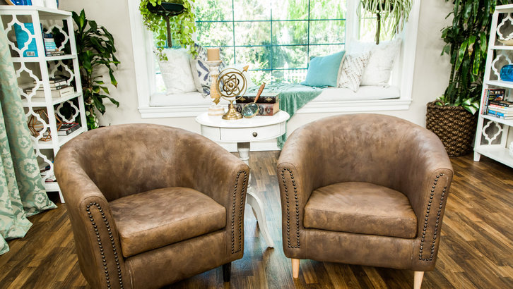 DIY faux leather chairs with nail trim (via www.hallmarkchannel.com)