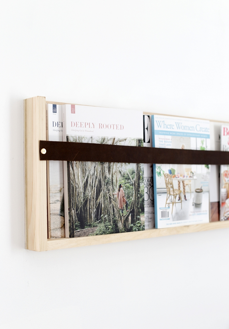DIY plywood leather magazine rack (via themerrythought.com)