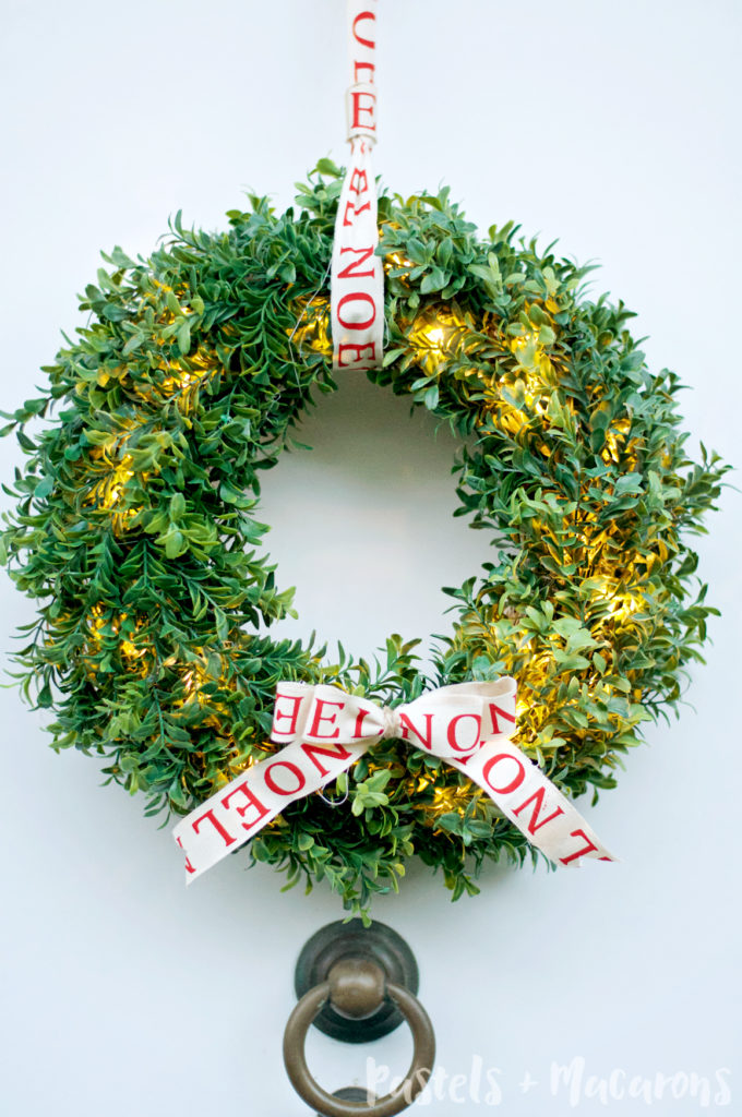 DIY faux boxwood Christmas wreath with lights (via www.pastelsandmacarons.com)