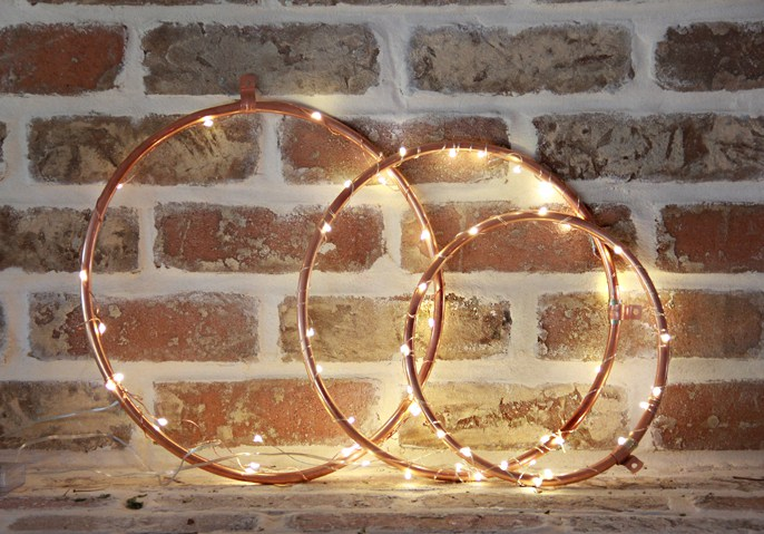 DIY copper hoops lights Christmas wreaths (via abubblylife.com)