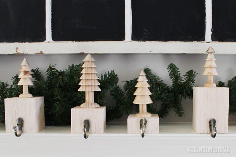 DIY wooden block and Christmas tree stocking holders (via www.atkinsondrive.com)