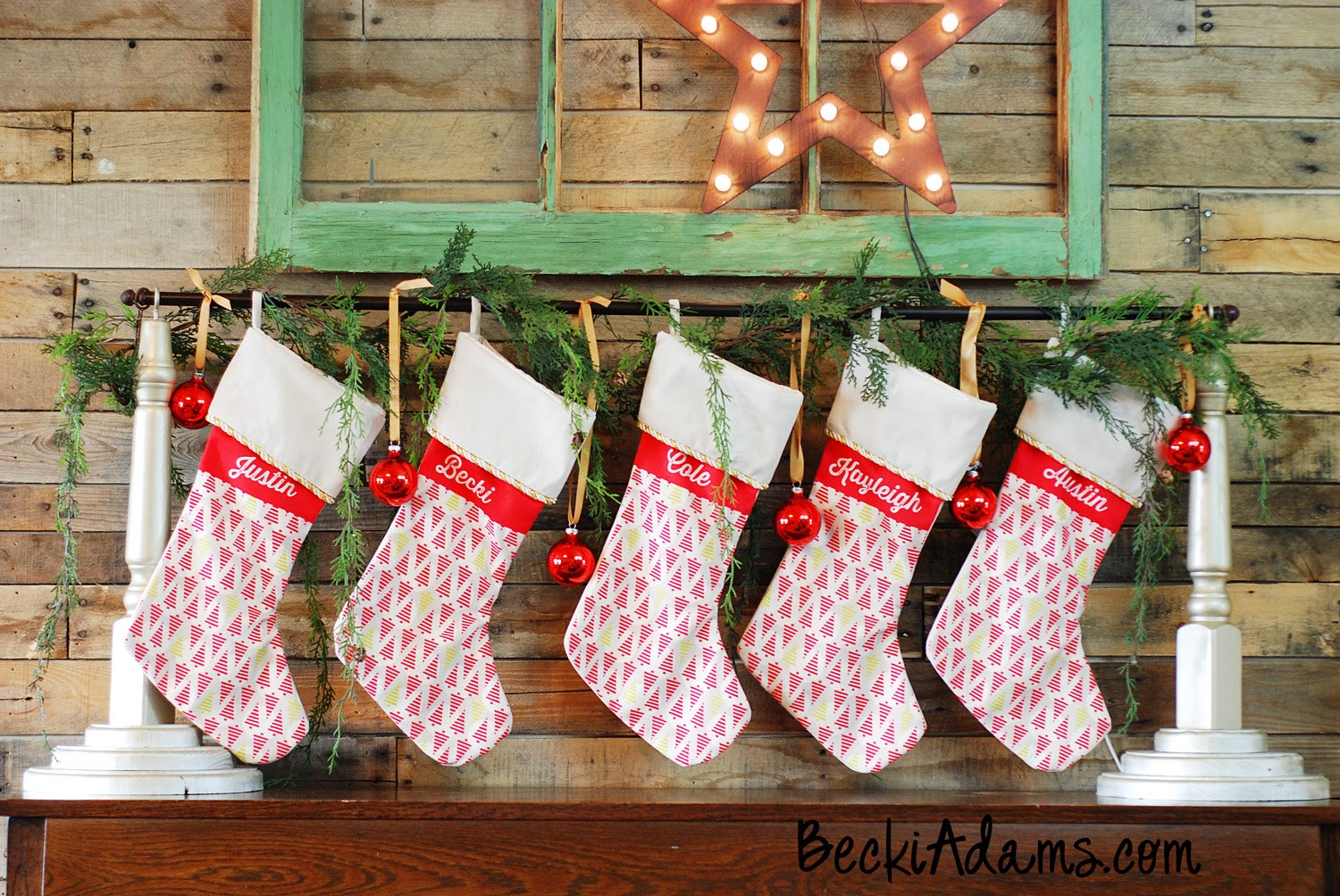DIY stocking holder with evergreens and ornaments
