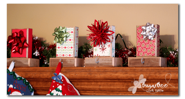 DIY colorful stocking hangers with bold paper and bows (via www.sugarbeecrafts.com)