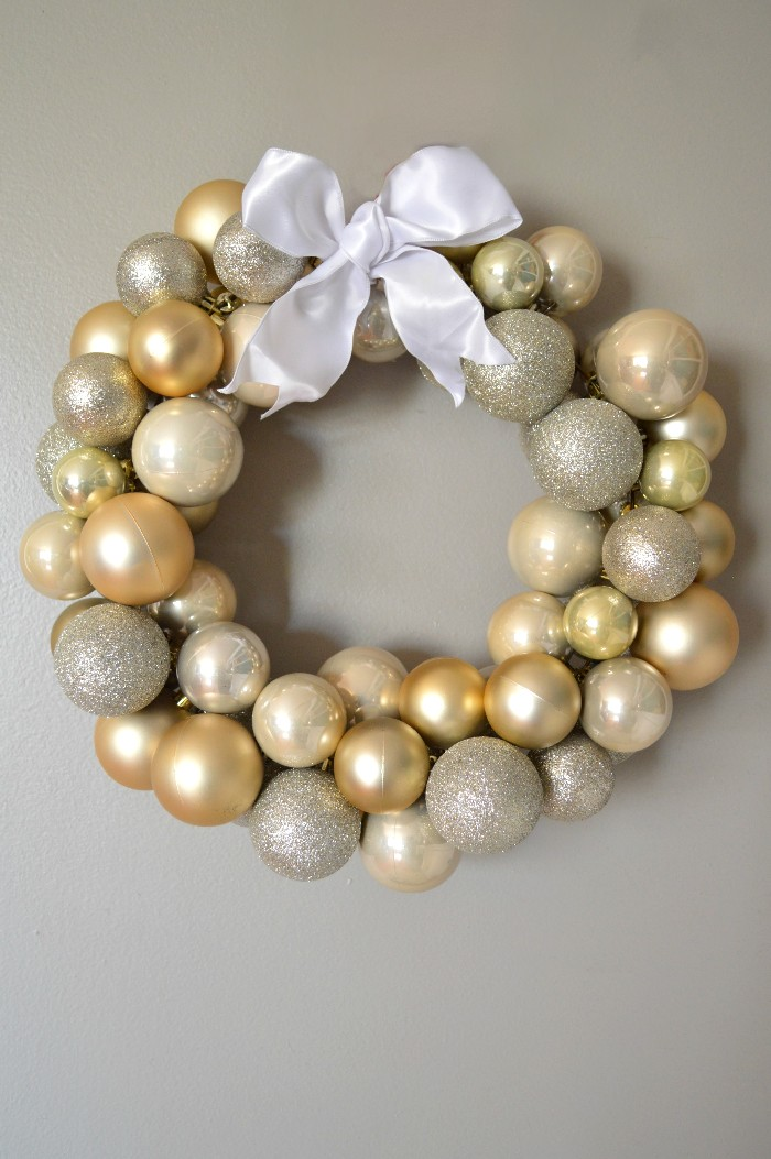 DIY mixed metallics Christmas ornament wreath (via madincrafts.com)