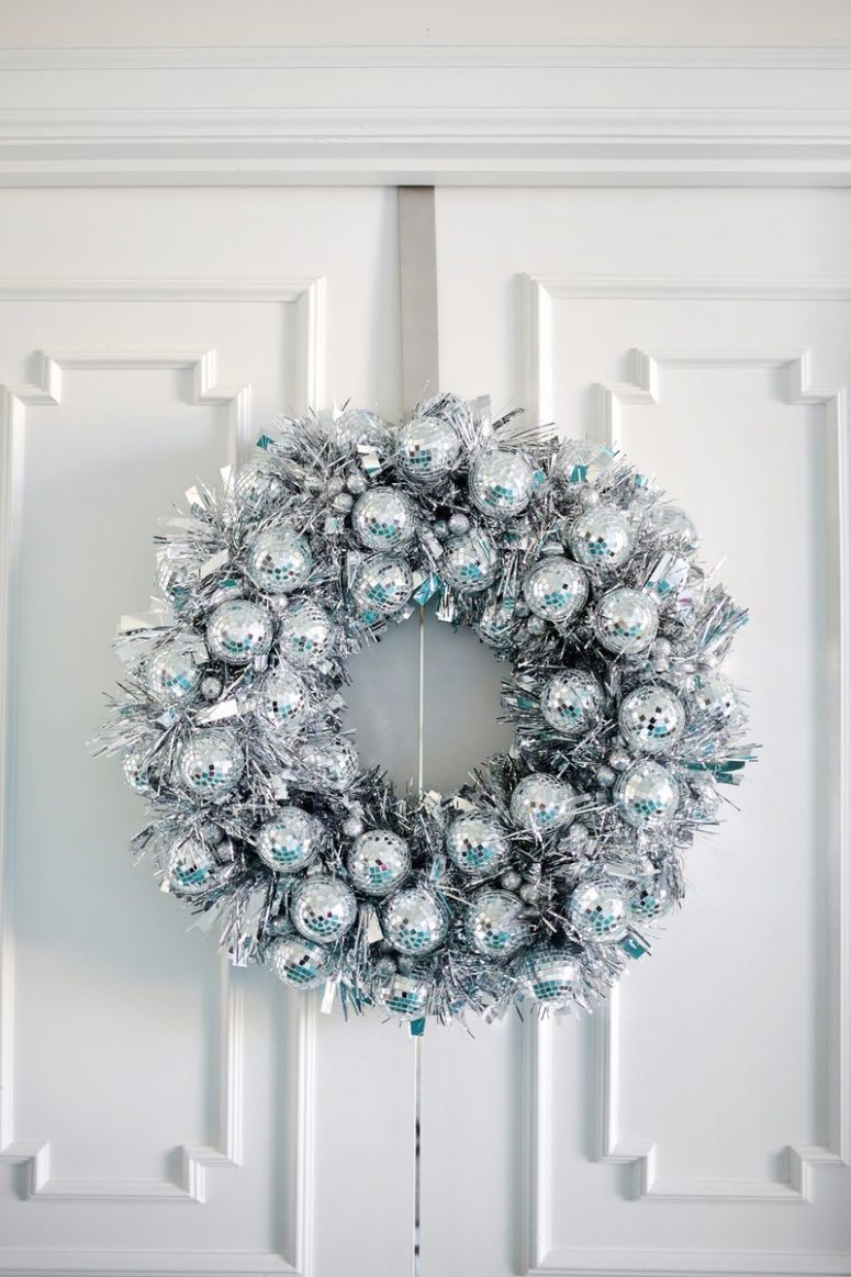 DIY silver tinsel and disco ball ornament wreath (via abeautifulmess.com)