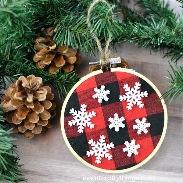 DIY buffalo plaid Christmas ornaments with snowflakes (via iheartcraftythings.com)