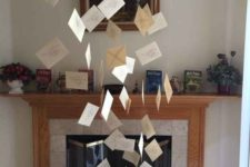 02 write and hang some letters over the fireplace for creating a magical effect and cool decor