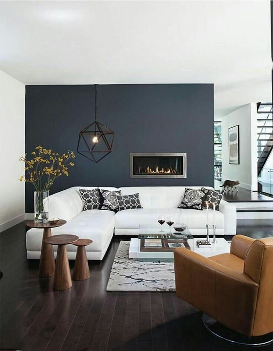 a black statement wall with a built-in ethanol fireplace that instantly adds cozines