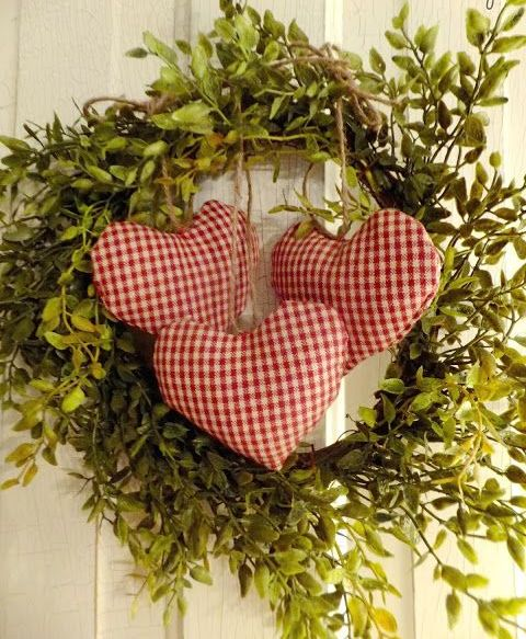 a cute boxwood wreath with checked hearts for a rustic or vintage space