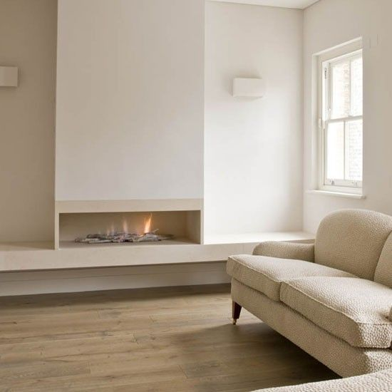 a neutral space with an ethanol fireplace, which looks very natural and adds wamrth to the space